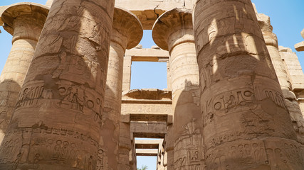 Karnak Temple in Luxor, Egypt. The Karnak Temple Complex, commonly known as Karnak, comprises a vast mix of decayed temples, chapels, pylons, and other buildings in Egypt.