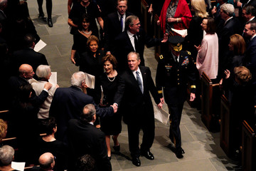 Former U.S. President George W. Bush shakes hands with mourners as the Bush family exit funeral service of former U.S. President George H.W. Bush