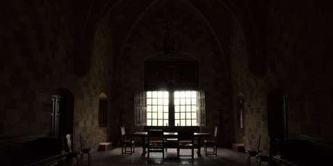 Abstract light shining through windows in old castle room