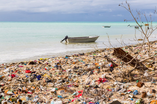Garbage dump, landfill on Micronesian atoll sand beach, South Tarawa, Kiribati, Oceania, South Pacific Ocean. Ecological, garbage problems of islands.