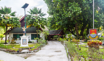 "President's residence, Government building with a monument, republic Coat of arms and Motto ""Te Mauri, Te Raoi ao Te Tabomoa"", South Tarawa, Kiribati"