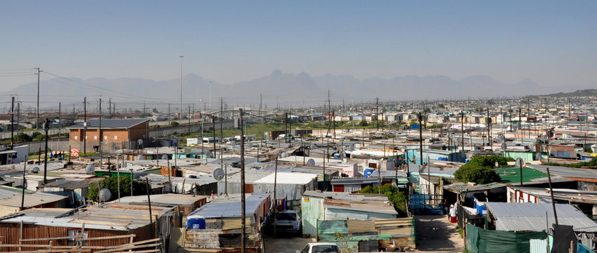 Panorama of Khayalitsha Township - the poorest slums - against the background of mauntains in Africa near Cape Town