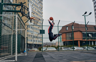 basketball player playing on the street