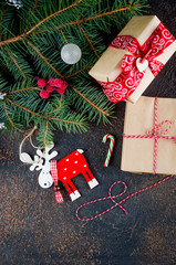 Christmas composition with Santa Claus, craft gifts and lights