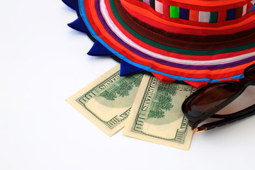 Colorful hat, 100 dollar bills on white background, isolate. Christmas, New Year and travel  concept.