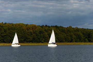 Spoed Foto op Canvas Zeilen Two sailboats sailing on the Masuria's lakes, Poland