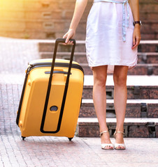 Girl traveler and suitcase