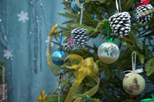Beautiful Christmas ornaments. Christmas decoration in the form of a yellow ball, in the
