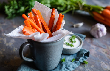 Carrot fries with sour cream and garlic dip