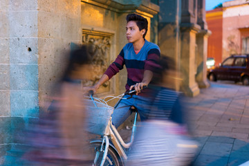 Young man on a bike in the city