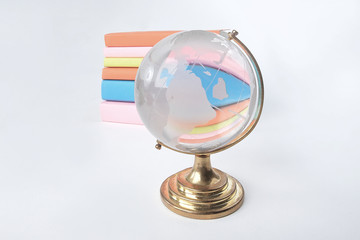 glass globe on the background of a stack of books .photo with copy space