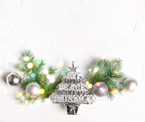Christmas background with christmas ornaments and fir branches
