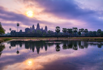 Amazing view of Angkor Wat temple at sunrise. The temple complex Angkor Wat in Cambodia is the largest religious monument in the world. Location: Siem Reap, Cambodia. Artistic picture. Beauty world