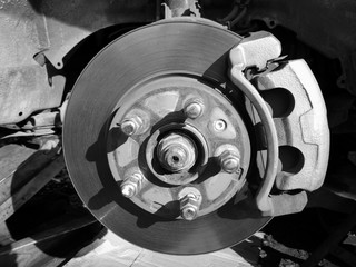 Disc brakes car / change new brake on disc brakes remove wheel car for repair in car service monochrome