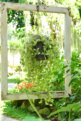 The Old White Frame in the garden with Vintage mood