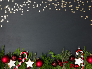 christmas background on black background with different red christmas items