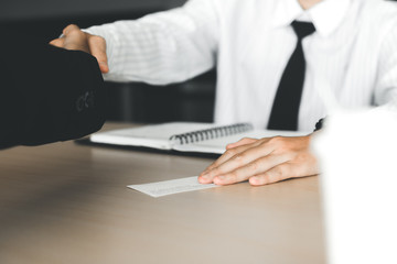 Department heads manager are shaking hands and filing business cards with agents.