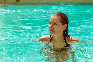 Young woman having fun in the pool