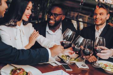 Businessmans Having Meeting In Indoor Restaurant