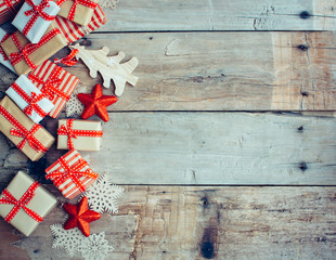 Christmas background with decorations and red gift boxes on the wooden board