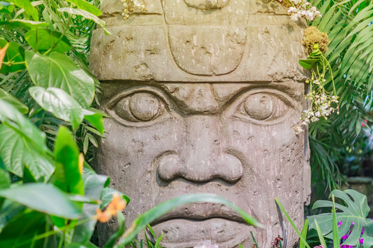 Close up of religious stone statue in tropical forest. Mayan antique  heritage