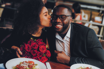 African American Couple Dating in Restaurant