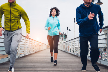 Group of sporty people running outdoor