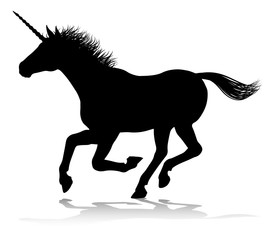 A unicorn silhouette mythical horned horse graphic