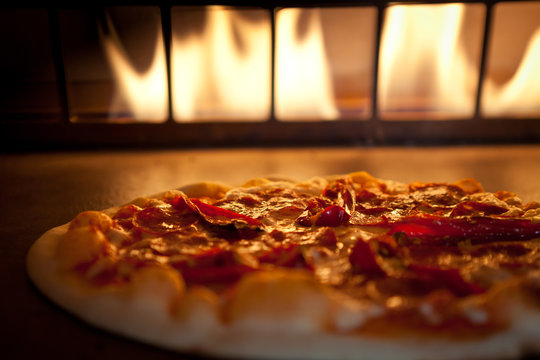 Pepperoni and Roasted pepper pizza in oven