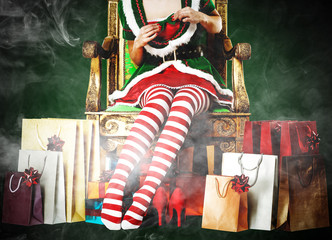 Christmas time and slim young woman legs with smoke decoration