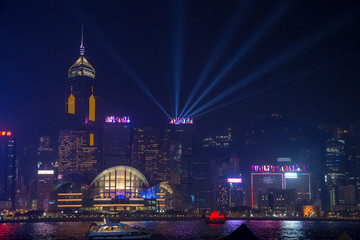 View Night of Symphony of Lights and two boat of life at Victoria Harbor in Hong Kong.