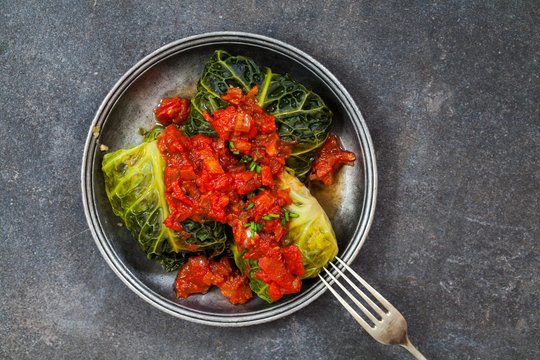 Cabbage rolls stuffed with mushrooms, leek and bulgur wheat and tomato sauce