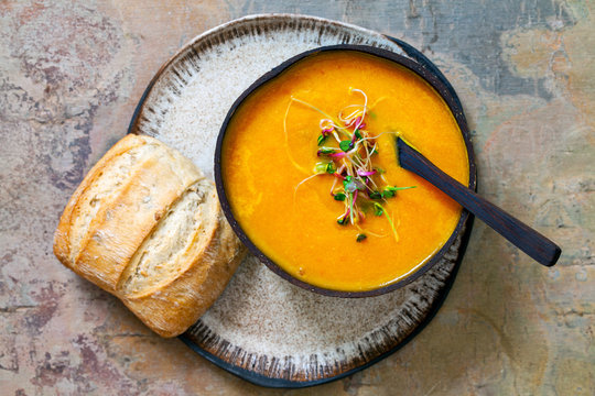 Carrot soup with the topping of green sprouts