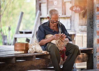 asia life old man uncle grandfather working countryside weave bamboo basket crafts