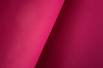 Background of shape and geometry. Colored background decorations with paper. Shades of pink.