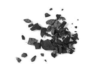Black charcoal pile isolated on white background, top view