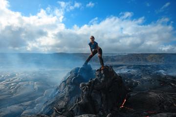 Extremal girl posing at Kilaulea volcano lava field