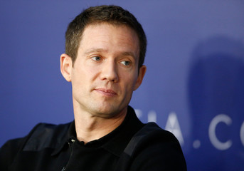 World Rally Champion Ogier listens during the FIA news conference in St. Petersburg