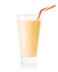 Banana or vanilla smoothie or yogurt in tall glass with striped