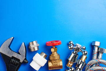plumbing tools and equipment on blue background with copy space Fototapete