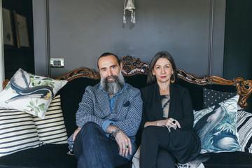 Couple sitting on antique sofa