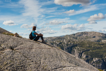 middle age hiker woman sitting on rock relaxing in Norway