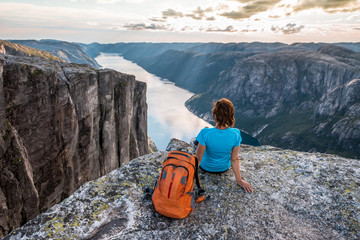 Sporty woman on the top of fjord near Kjeragbolten, Norway.