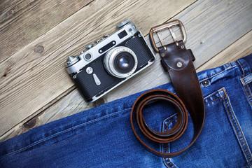 old blue jeans, vintage leather belt and ancient rangefinder camera