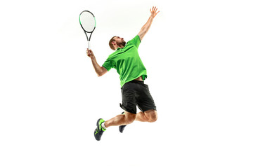 Fototapeta The one caucasian man playing tennis isolated on white background. Studio shot of fit young player at studio in motion or movement during sport game.. obraz