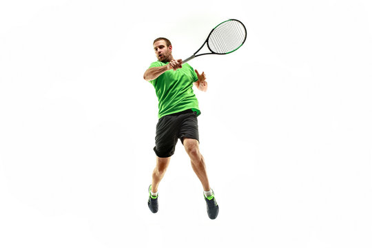 The one caucasian man playing tennis isolated on white background. Studio shot of fit young player at studio in motion or movement during sport game..