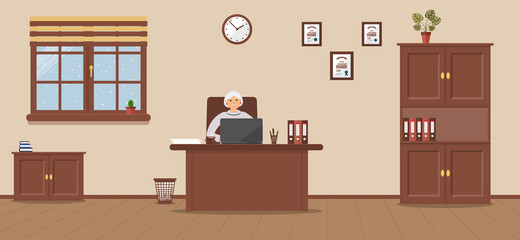 An elderly woman sitting in the workplace in a spacious office on a cream background. Vector illustration.Table, wardrobe, monstera,diplomas. It`s snowing outside.Wooden floor. Perfect for advertising