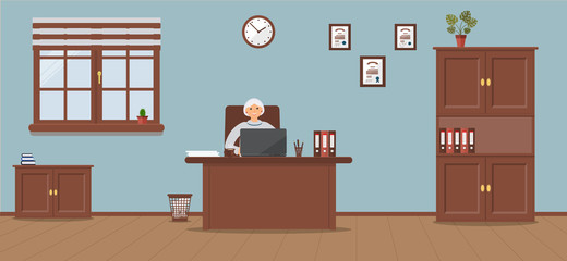 An elderly woman sitting in the workplace in a spacious office on a light blue background. Vector illustration.Table, wardrobe, monstera, diplomas. Wooden floor. Perfect for advertising