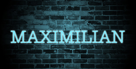 first name Maximilian in blue neon on brick wall