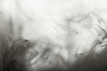 Wall Mural - abstract smoky background with paint swirls